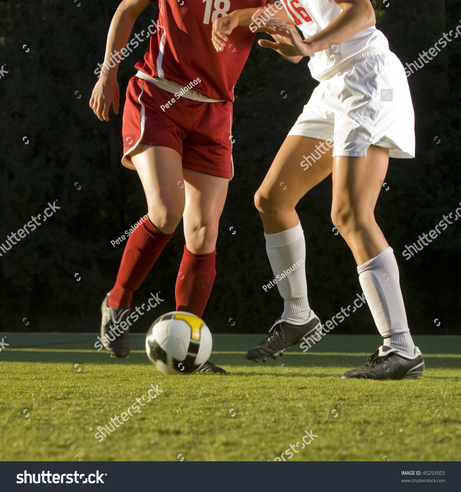 Soccer field with ball and players