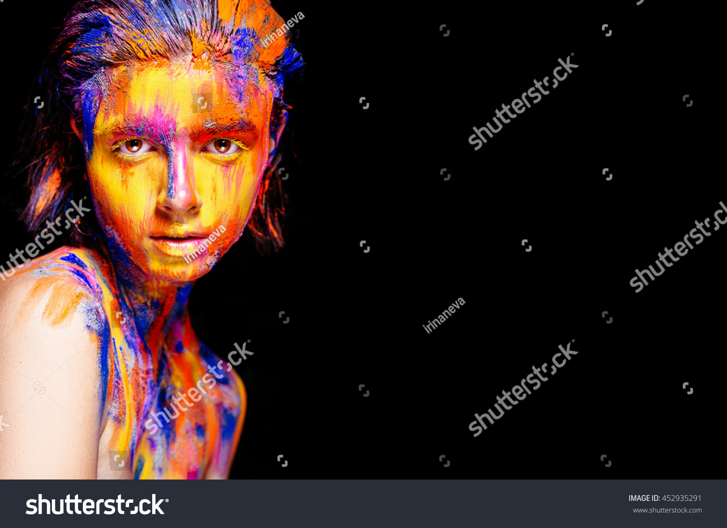Art makeup. Face, neck and hair girls smeared with bright colors of yellow,  blue and pink colors. Holi Festival | EZ Canvas