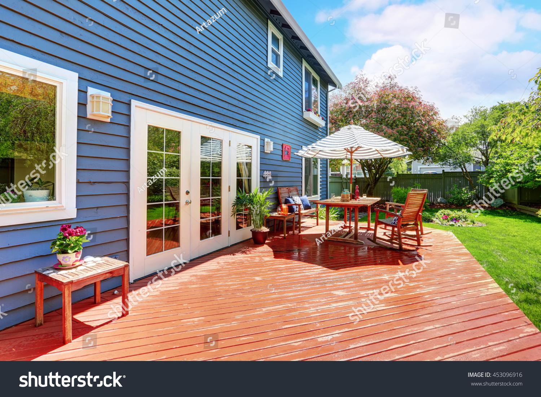wooden walkout deck backyard garden blue stock photo 453096916