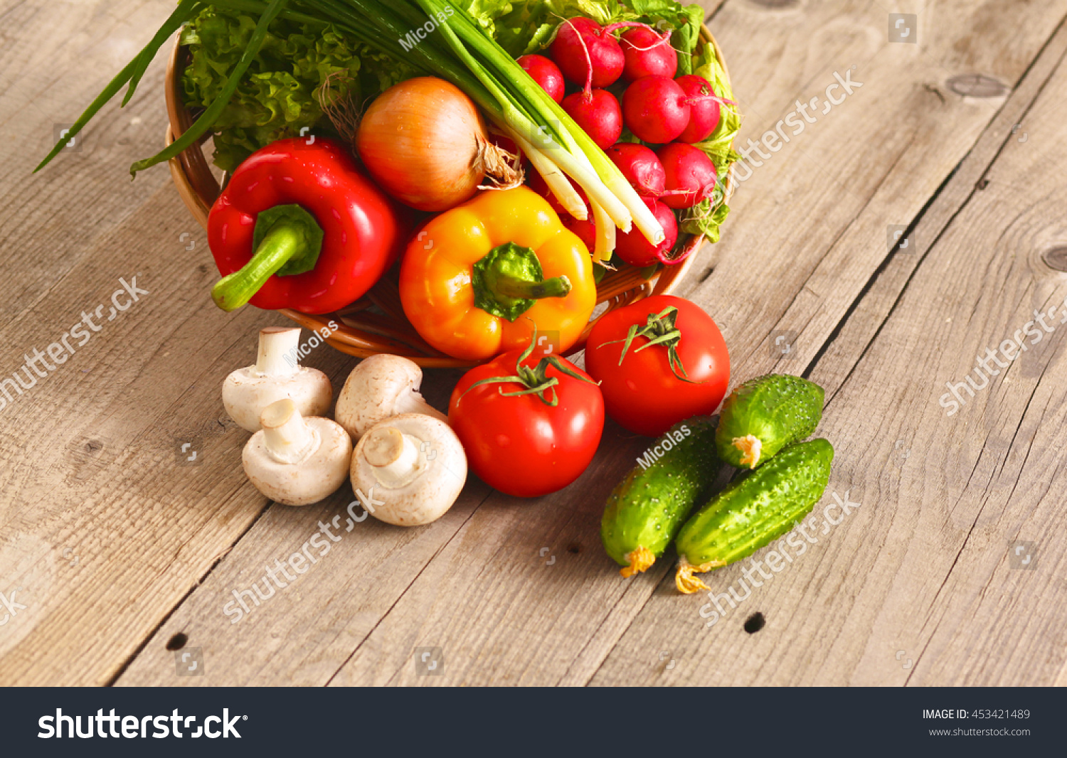 Fresh Vegetables On A Clean Wooden Table Stock Photo 453421489
