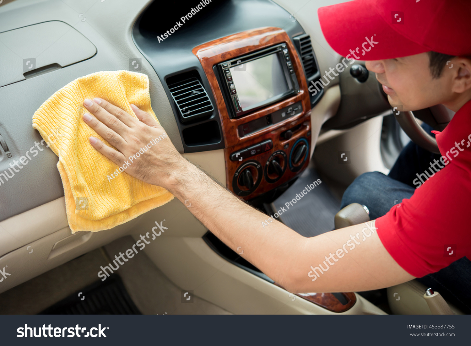 A man cleaning car interior car detailing and valeting concept