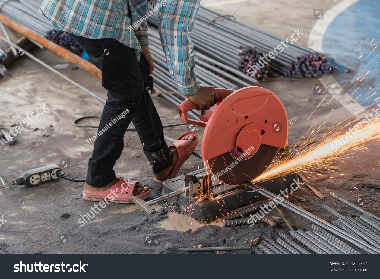 Buildings In A Cement Grinding Mill : Construction builder worker grinder machine cutting stock