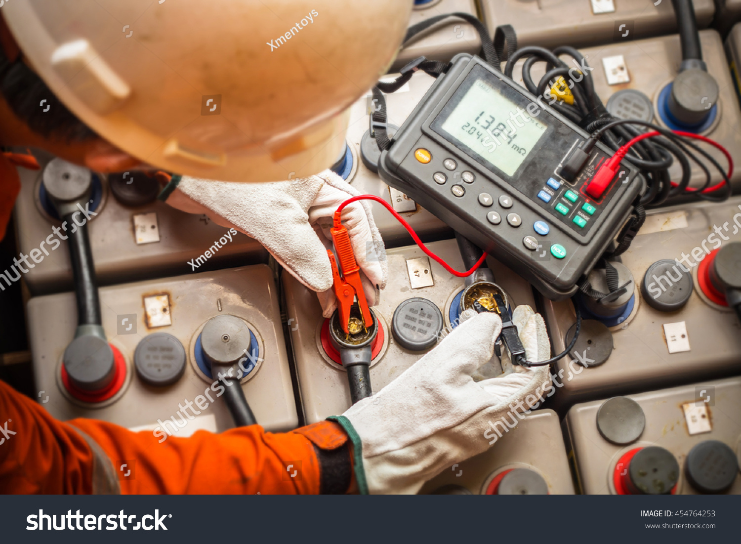 Electrician Using Digital Battery Tester Check Stock Photo Edit Now Electrical Testers The To Resistance And Voltage Of Batteries