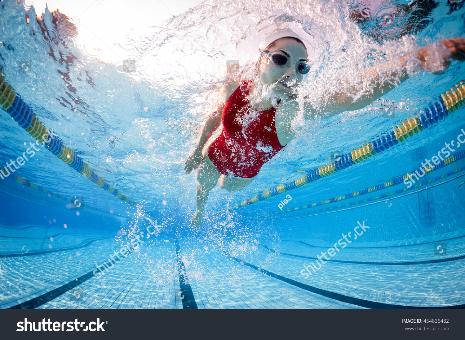 Professional Woman Swimmer Inside Swimming Pool.