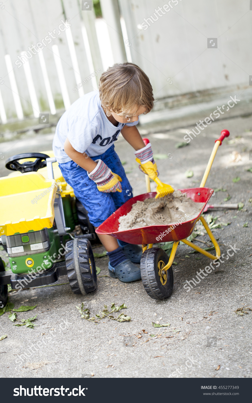 Boy On Tractor : Small boy on his toys tractor stock photo