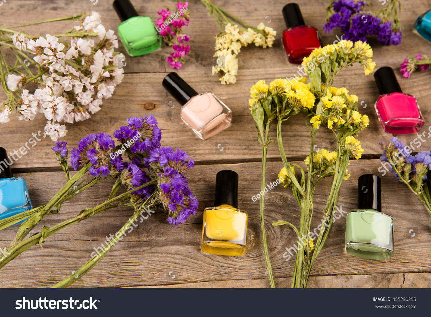 Bottles colorful nail polish flowers on stock photo 455290255 bottles of colorful nail polish and flowers on brown wooden table izmirmasajfo