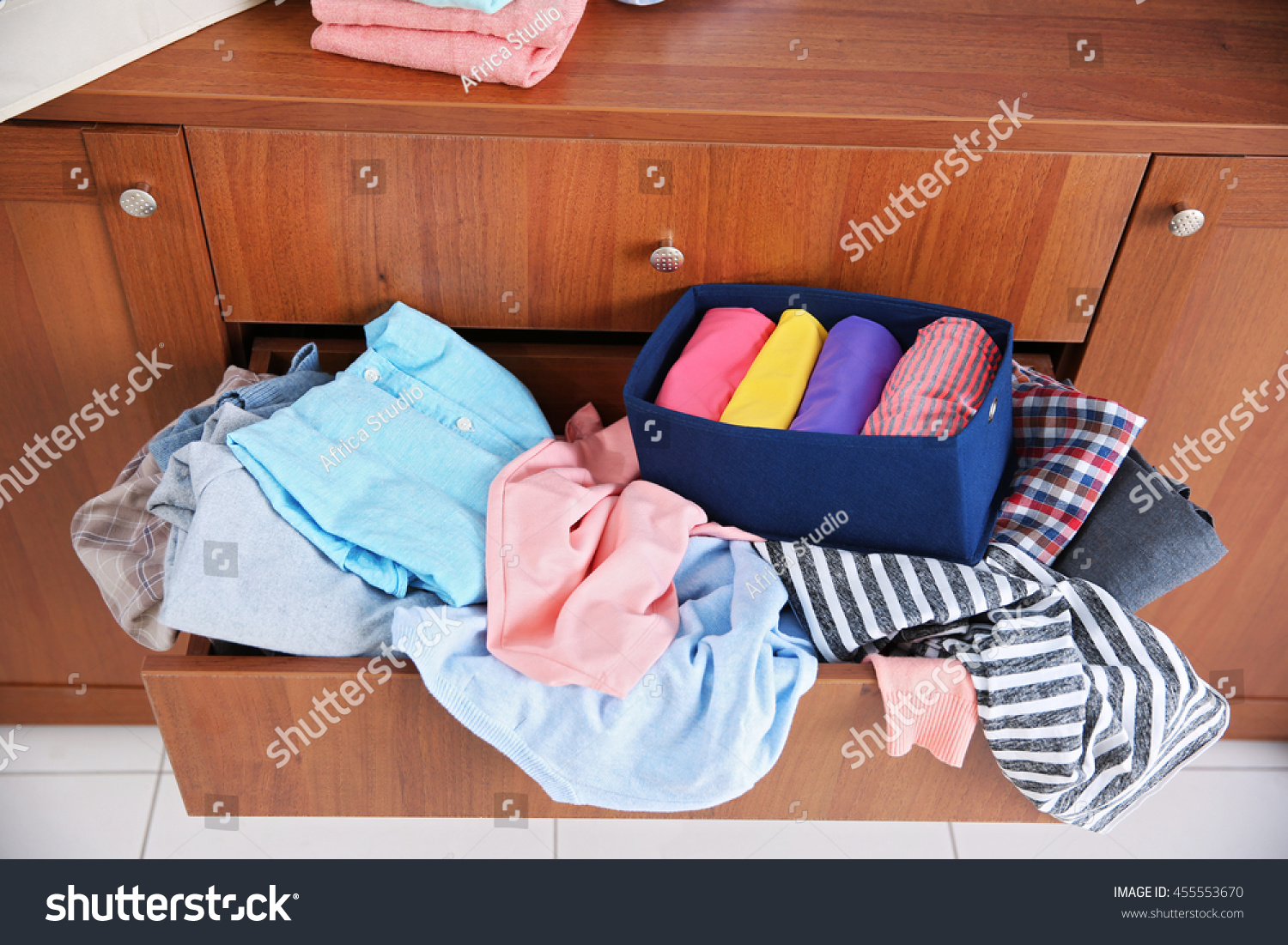 Amazing photo of Pile Of Clothes In Wooden Drawer Stock Photo 455553670 : Shutterstock with #A44827 color and 1500x1101 pixels