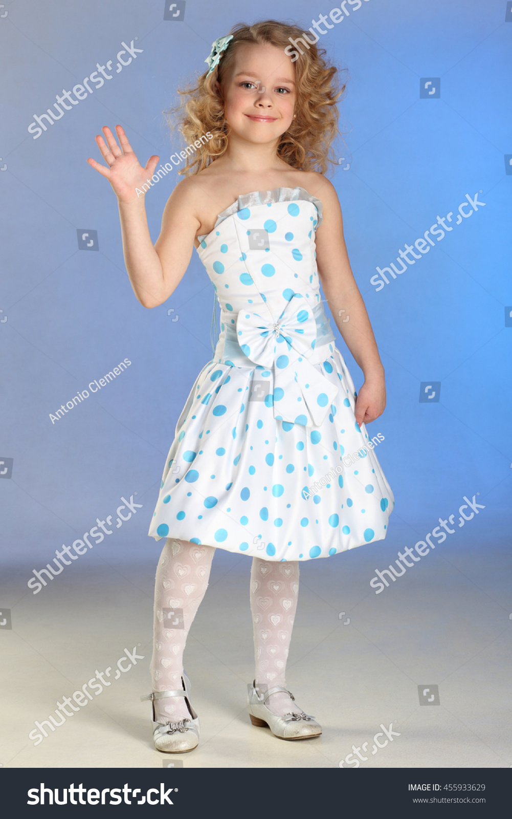 Baby in white dress and white tights