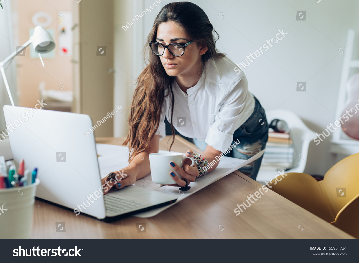 running home office. Running Her Business From Home.young Woman Working On A Computer In Home Office G