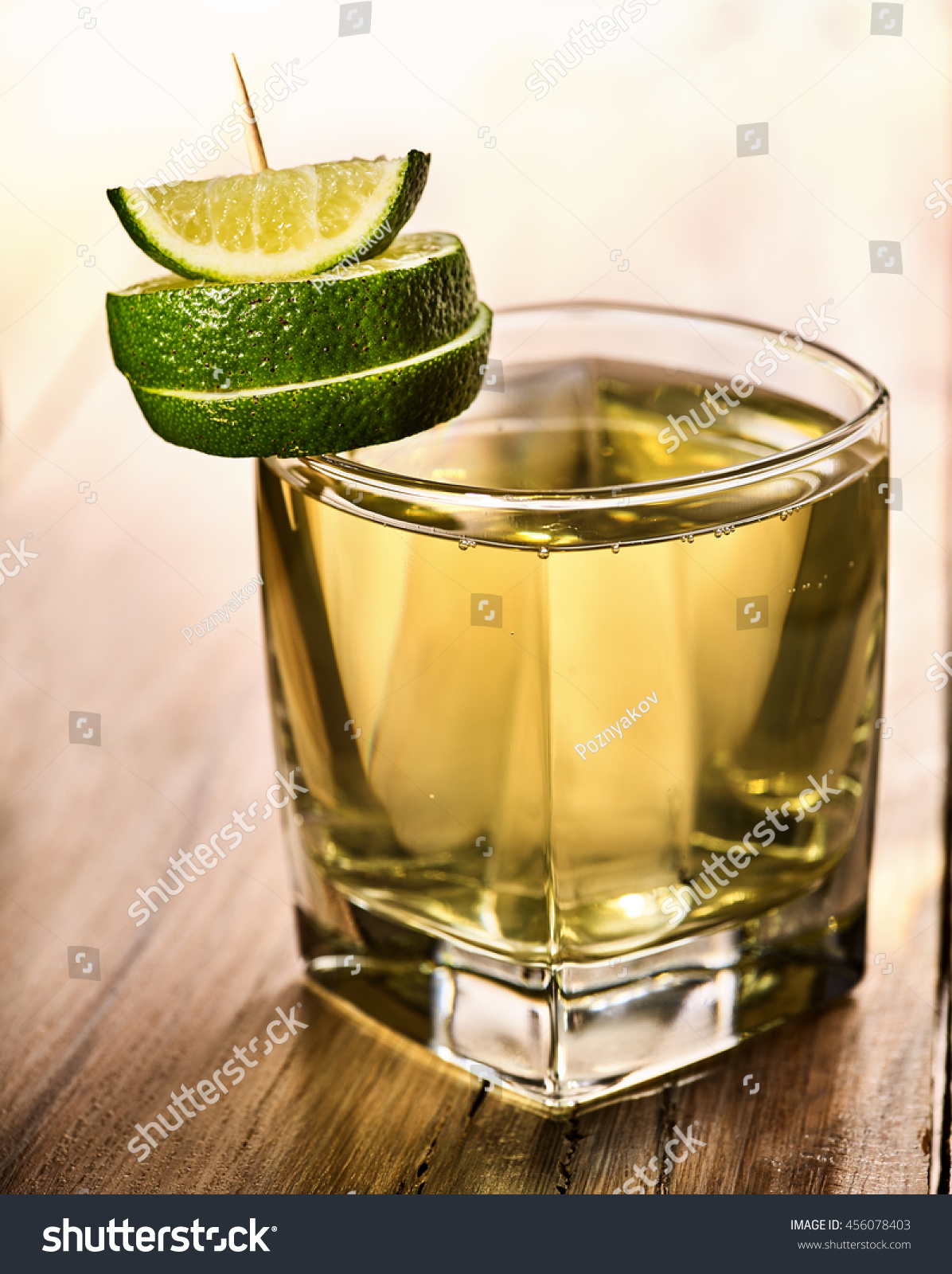 Alcohol cocktail on wooden boards glass stock photo for Mixed drinks with green tea