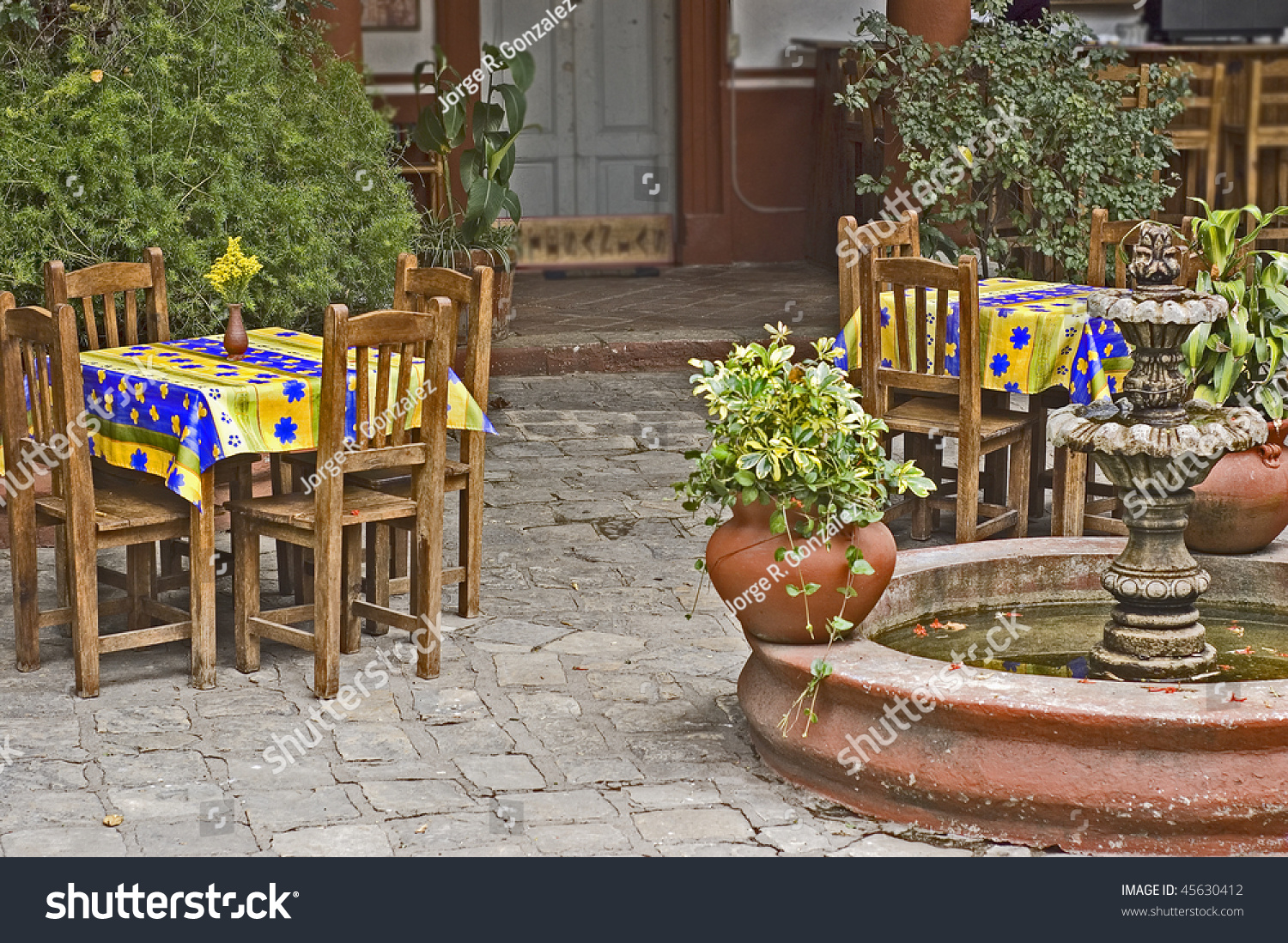 Courtyard Mexican Restaurant Fountain Colorful Tables