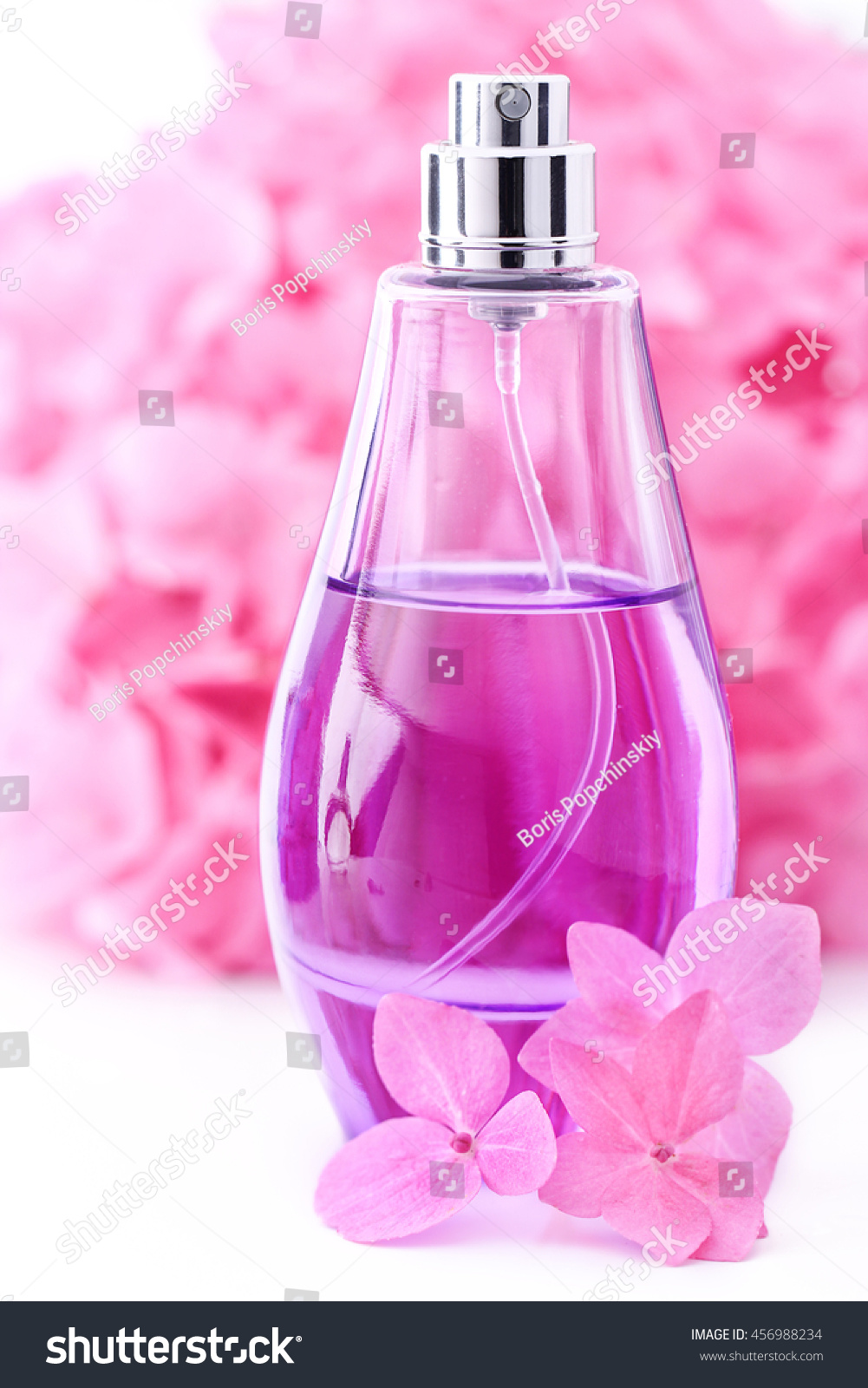 Perfume Bottle With Flowers On A White Background Ez Canvas
