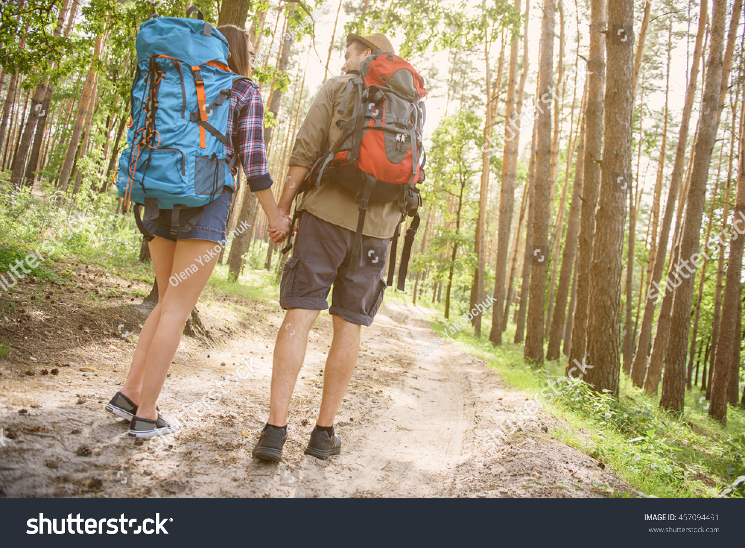 Cheerful young tourists hiking nature stock photo for Cheerful nature