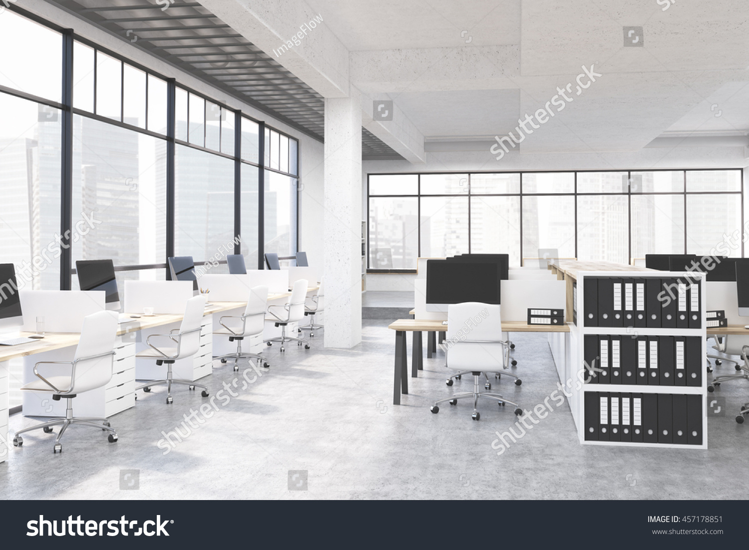 Large office workplace in clean modern style. Computers on tables. Binders  on shelves.