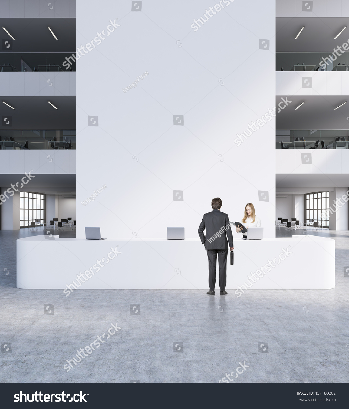 suits office. Reception In Modern Office. Man And Woman Suits Standing Front Of Big White Office U