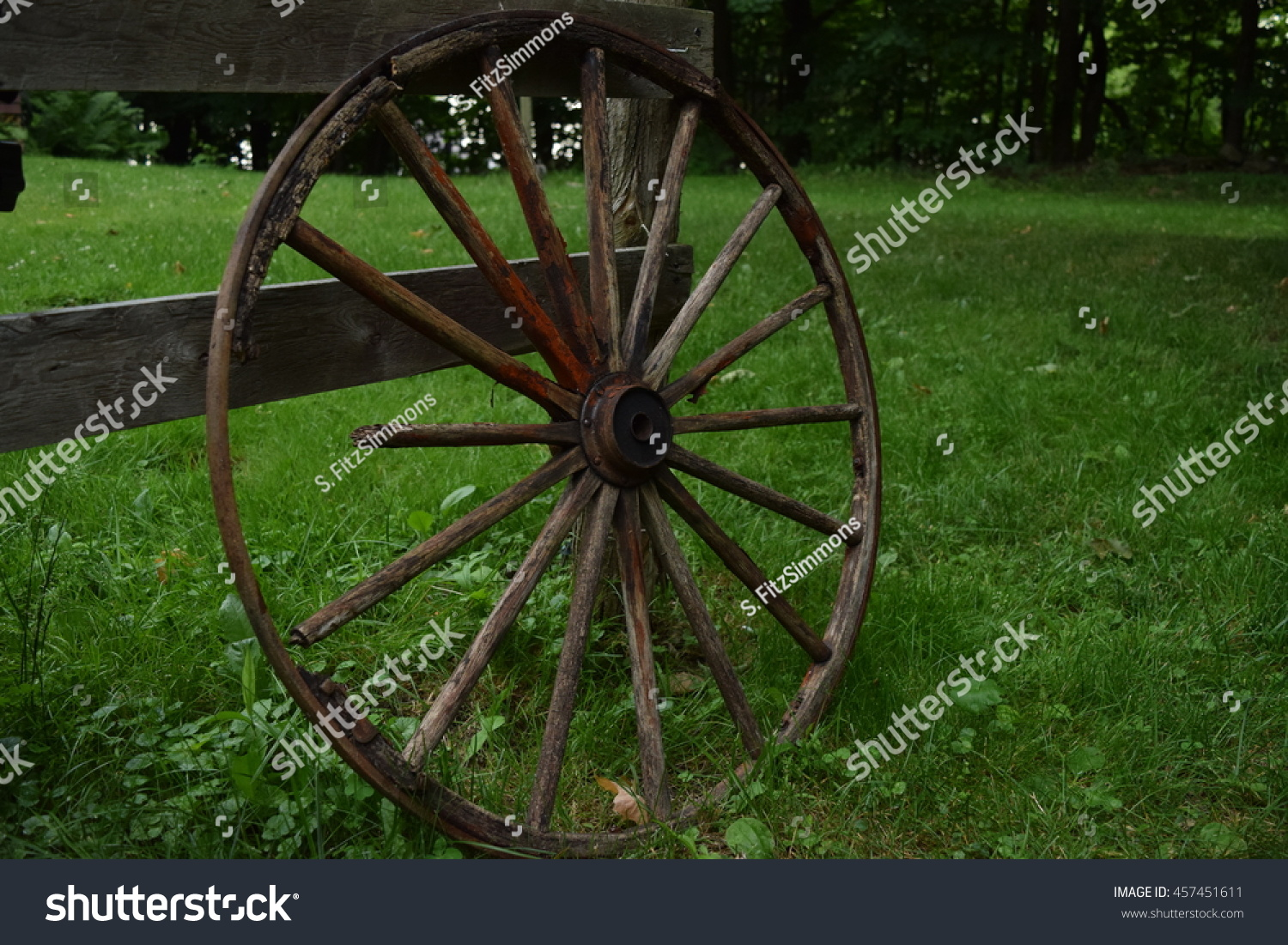 Old Wagon Wheel Against Fence Stock Photo Edit Now 457451611