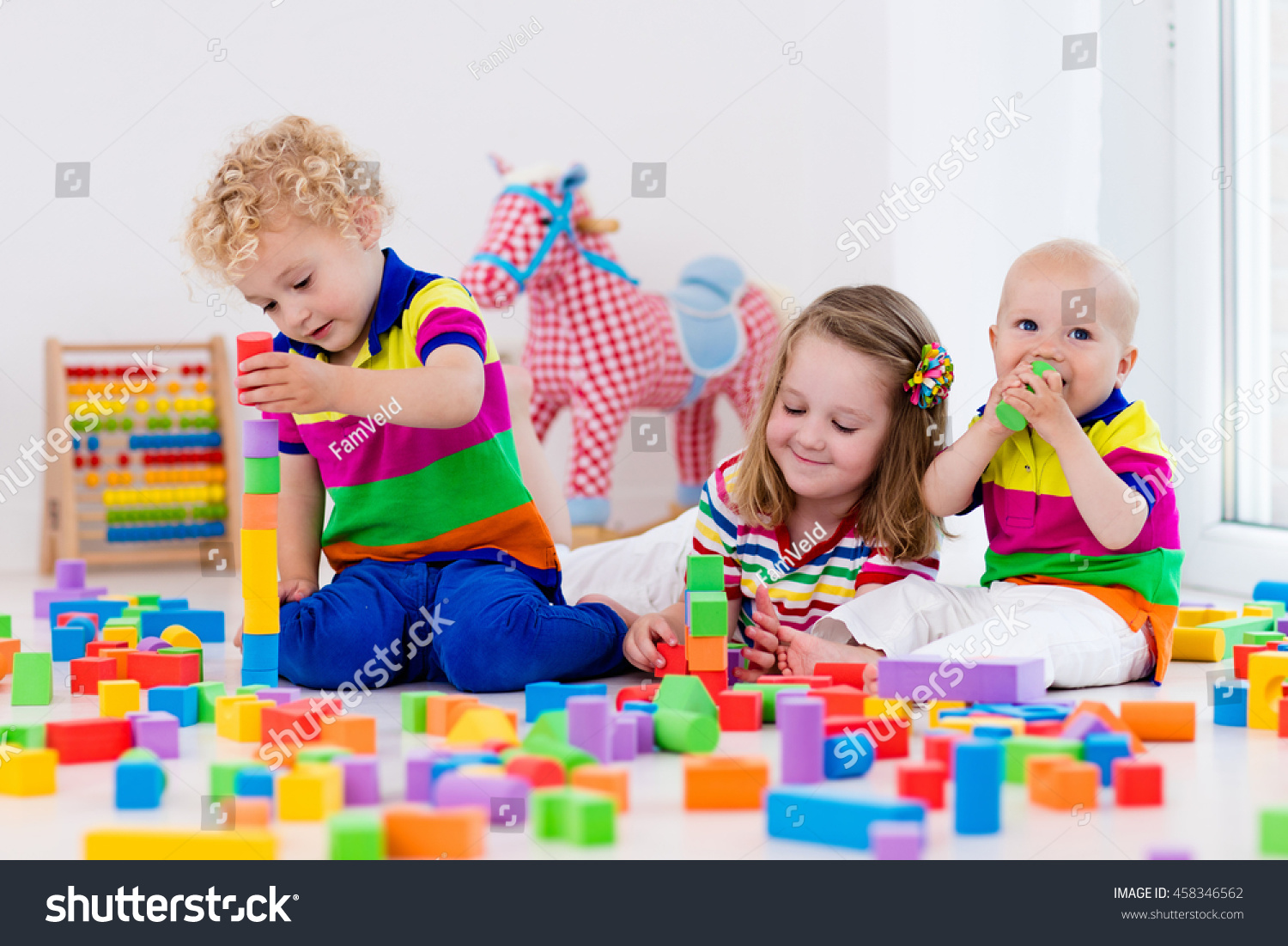 Day Care Toys For Toddler : Happy preschool age children play colorful stock photo