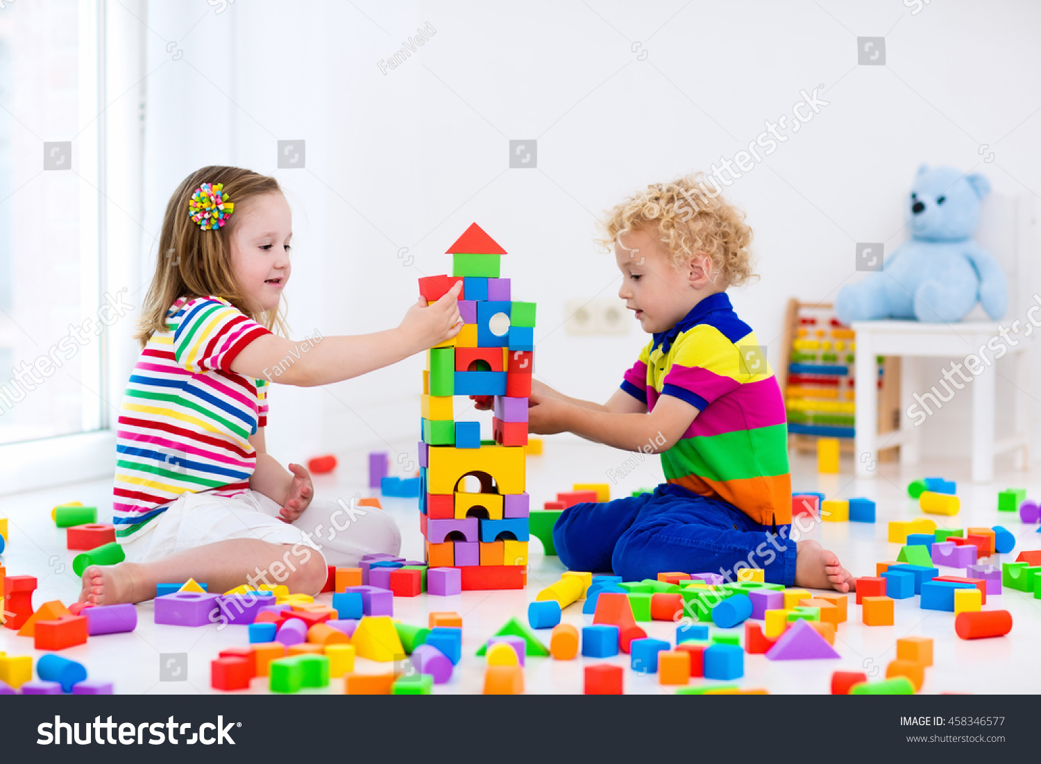 Toys For Kindergarten : Happy preschool age children play colorful stock photo