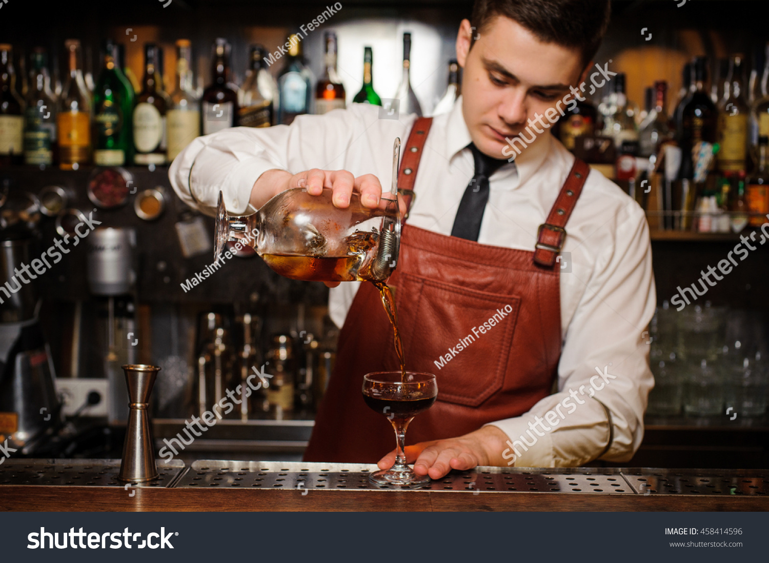 Bartender pouring fresh cocktail fancy glass stock photo for Cocktail bartender