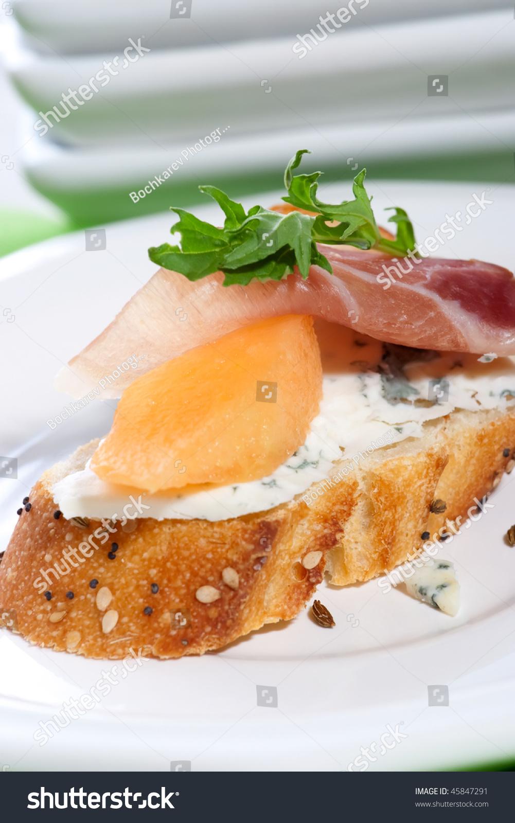 Closeup of delicious prosciutto canape sandwiche made from for Prosciutto canape
