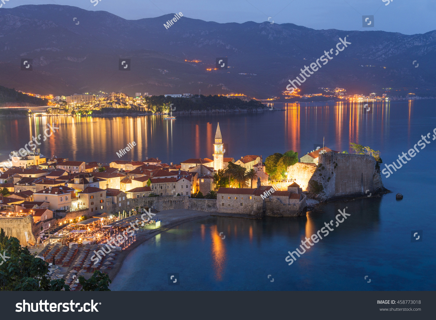 Budva Old Medieval Walled City Lights At Night. Center Of Montenegrin  Tourism, Medieval Walled
