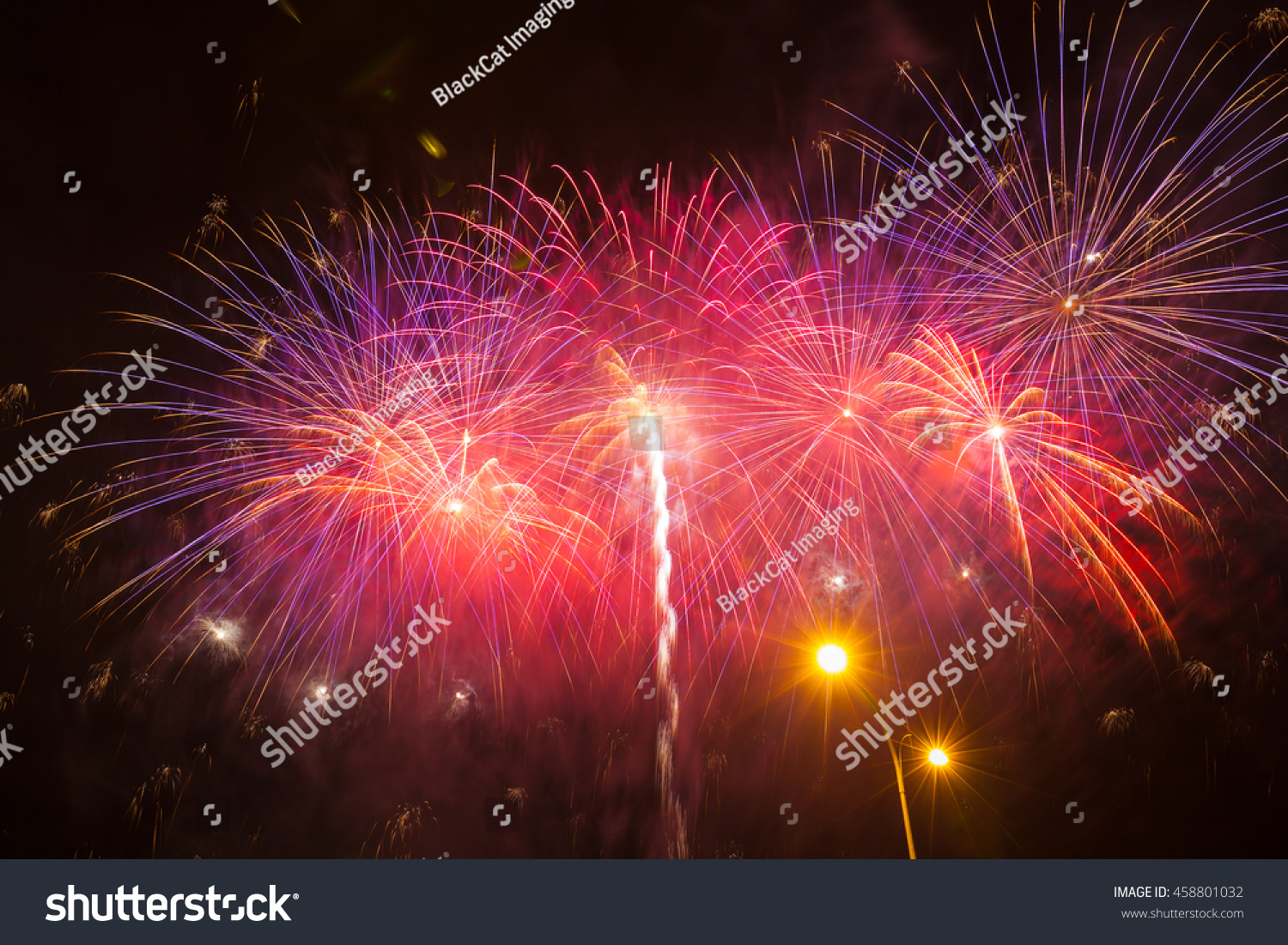 Red Fireworks Free Stock Photo: Multiple Red Purple Fireworks With Trails Stock Photo