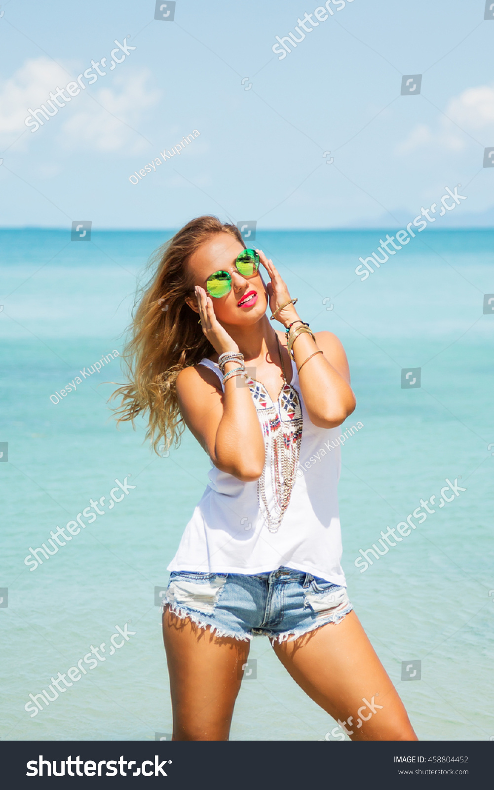 Summer fashion portrait of young pretty blonde woman with tanned fit sexy  body, wearing white