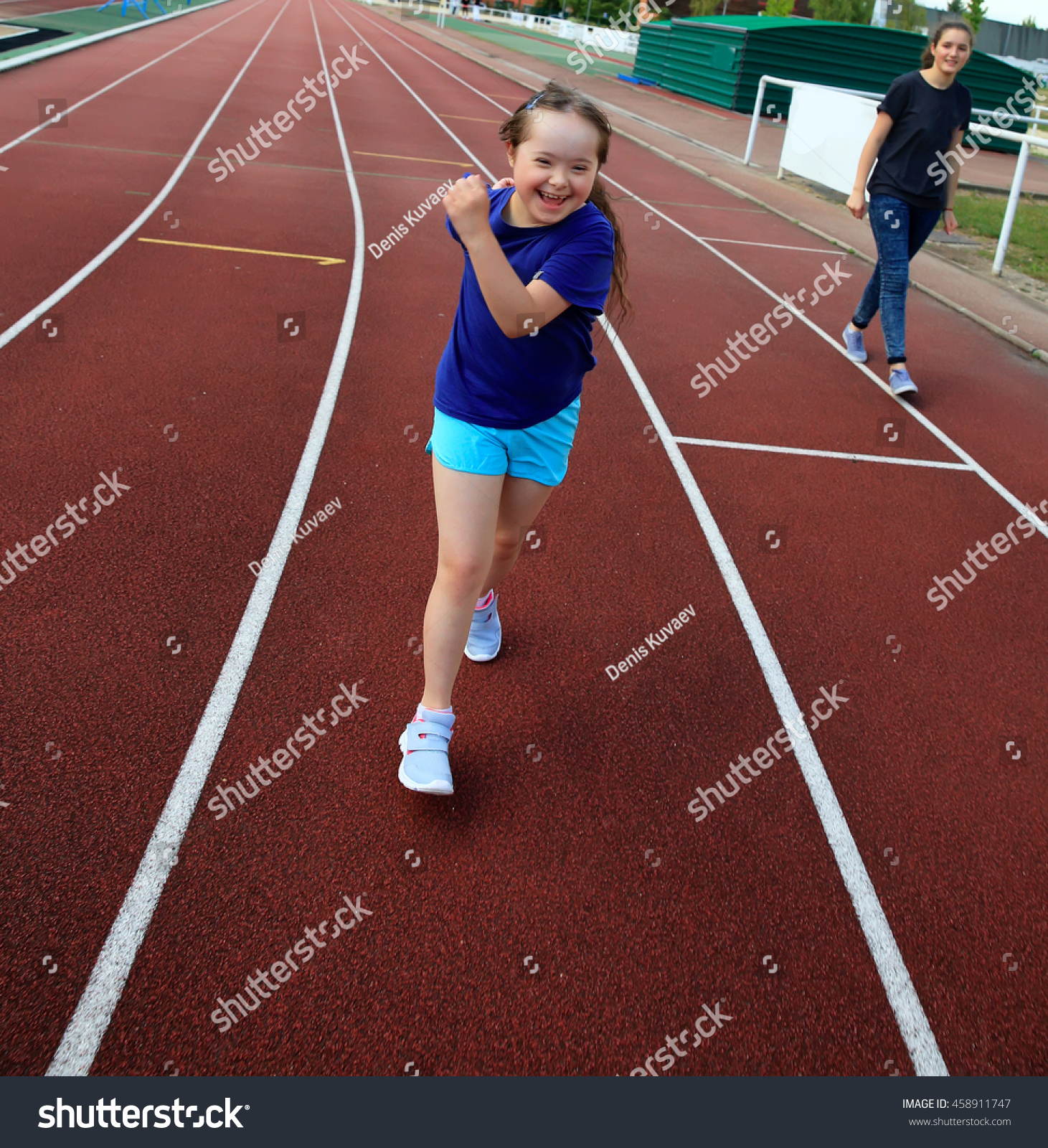 Little girl have fun on the stadium