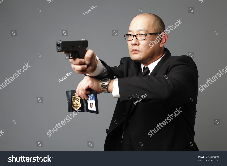 man with gun badge -#main