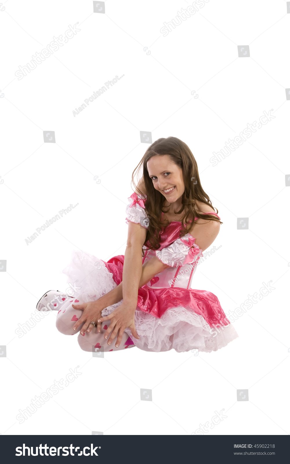 A woman being playful in a Valentines outfit showing her sexy side by her  expression on