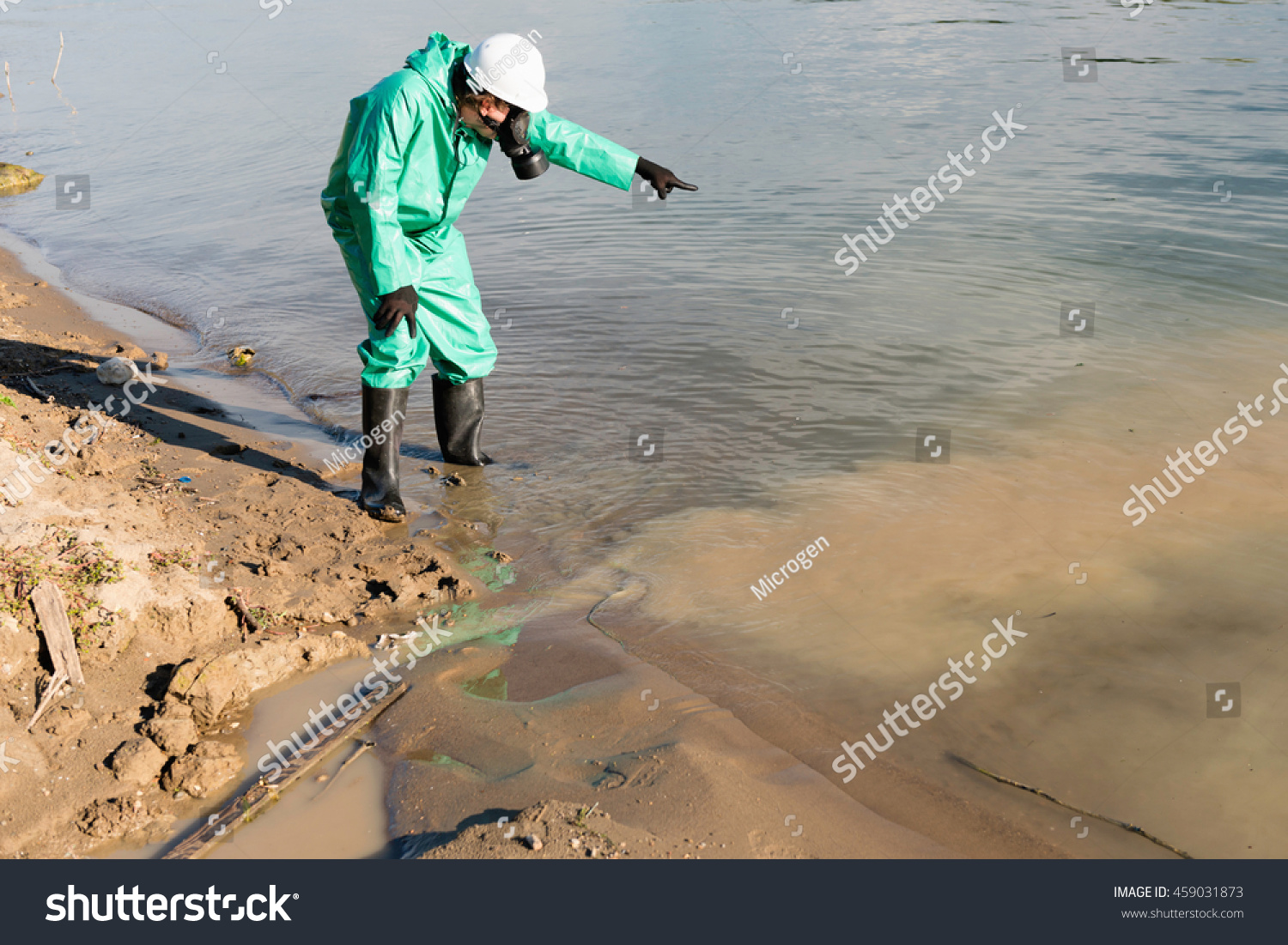 Environmentalist pointing to water pollution