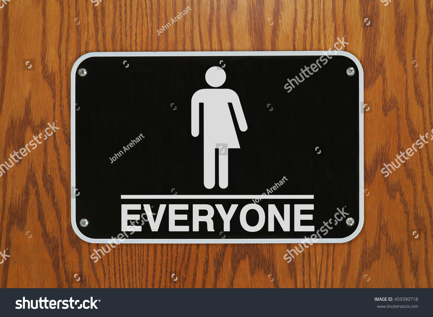 Gender Neutral Restroom Sign With Stick Stock Photo