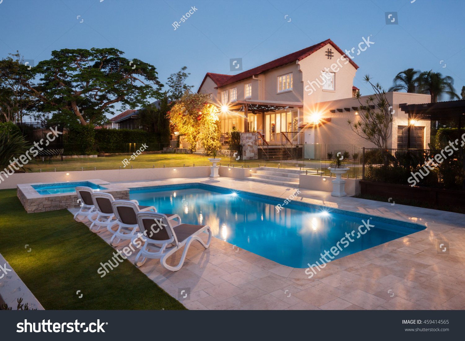 view modern house lights. View Of A Modern House Or Hotel From The Pool Side Corner With Blue Water Illuminated Lights