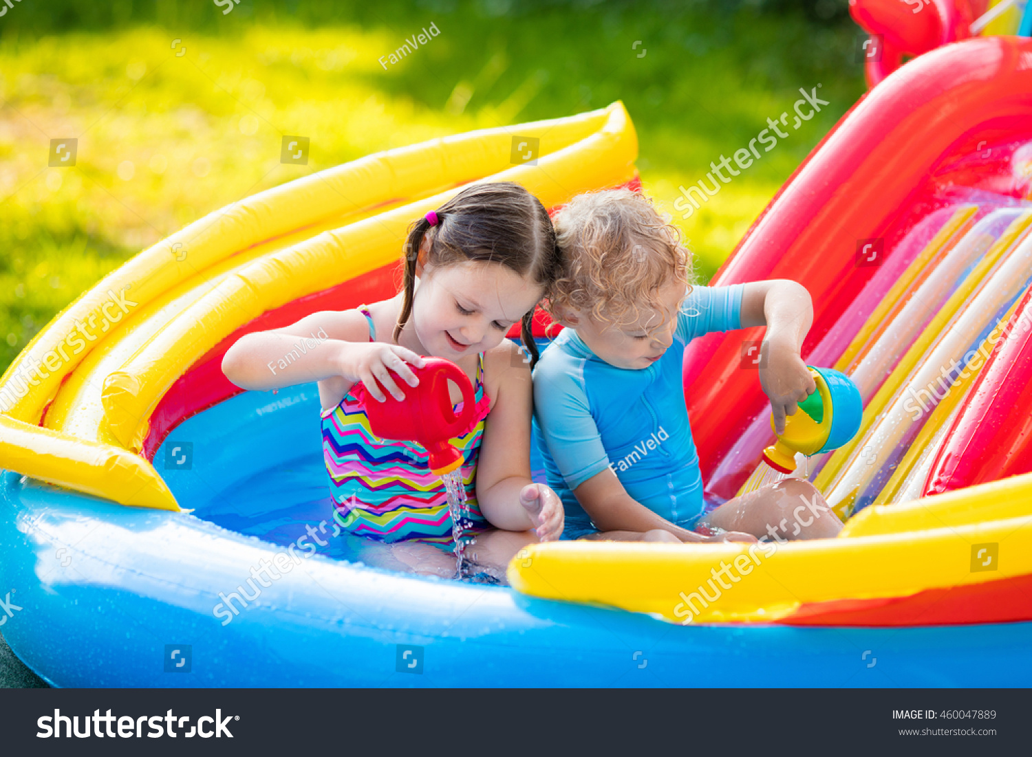 Children playing inflatable baby pool kids stock photo for Children s garden pools