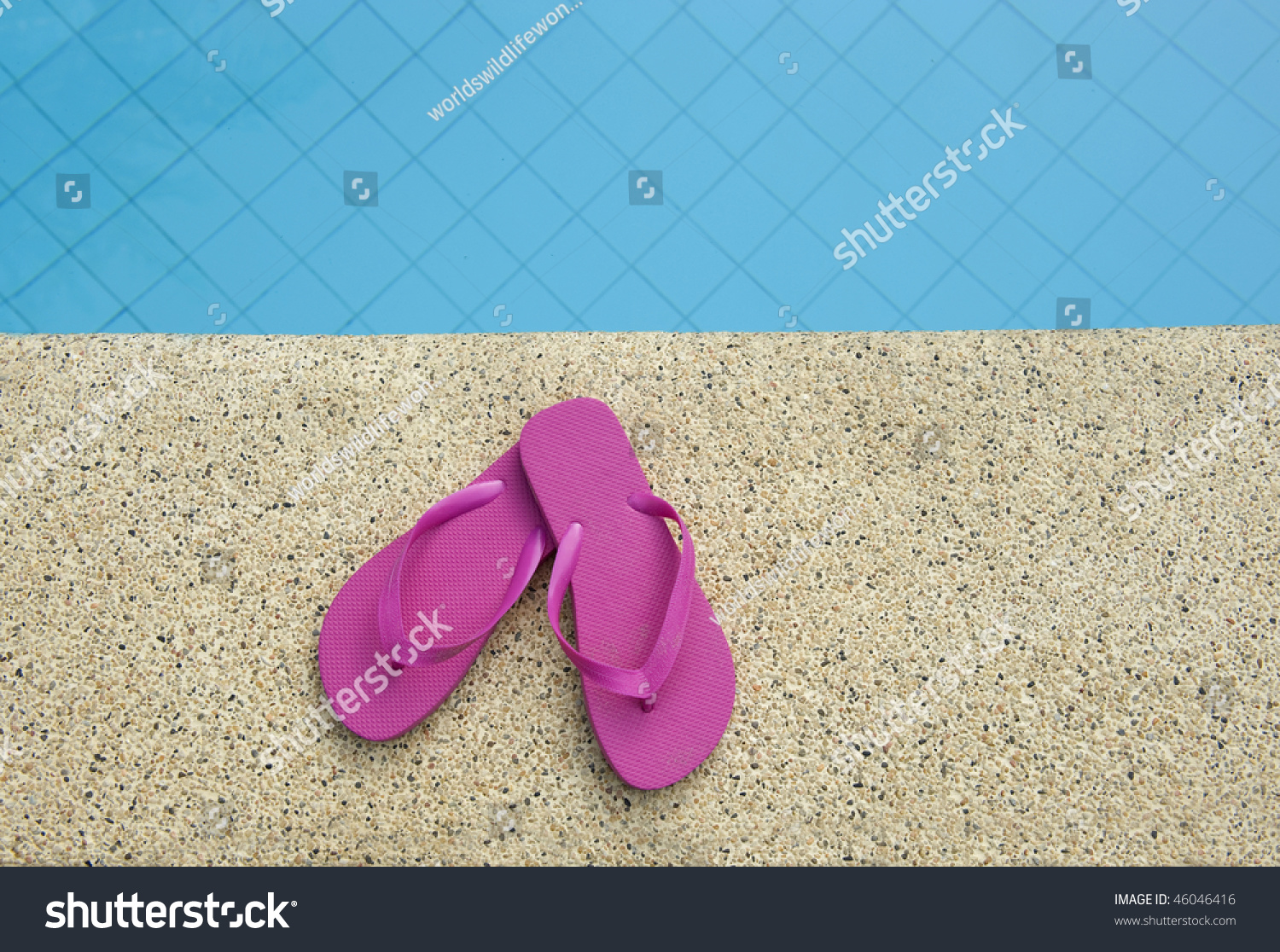 Pink shoes near edge swimming pool stock photo 46046416 - How to make swimming pool water blue ...