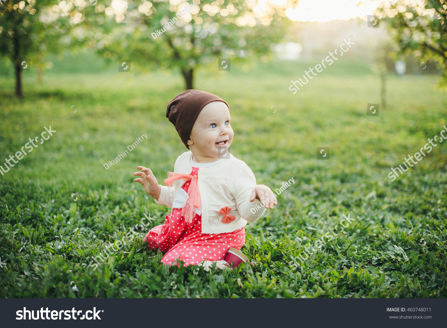 nice baby girl green meadow stock photo (100% legal protection