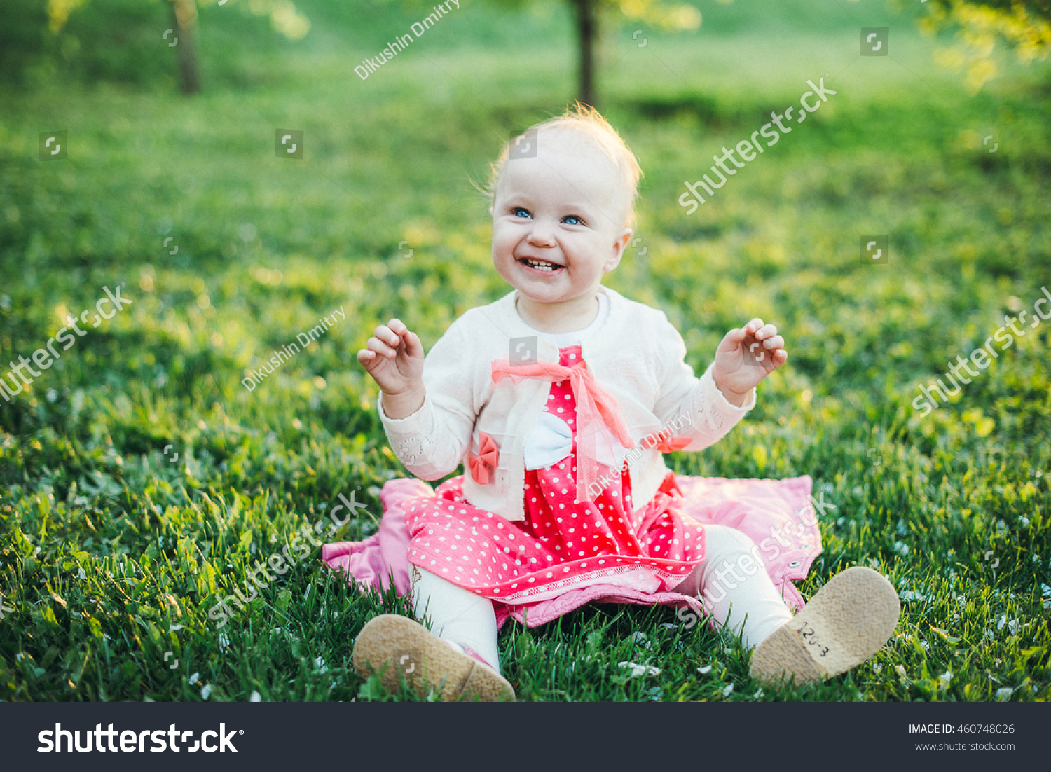 nice baby girl green meadow stock photo (royalty free) 460748026