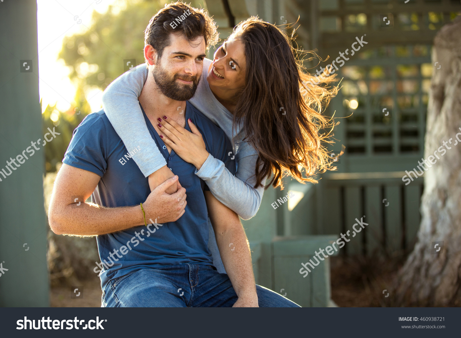 beautiful engaged couple fiance hug kiss stock photo (royalty free