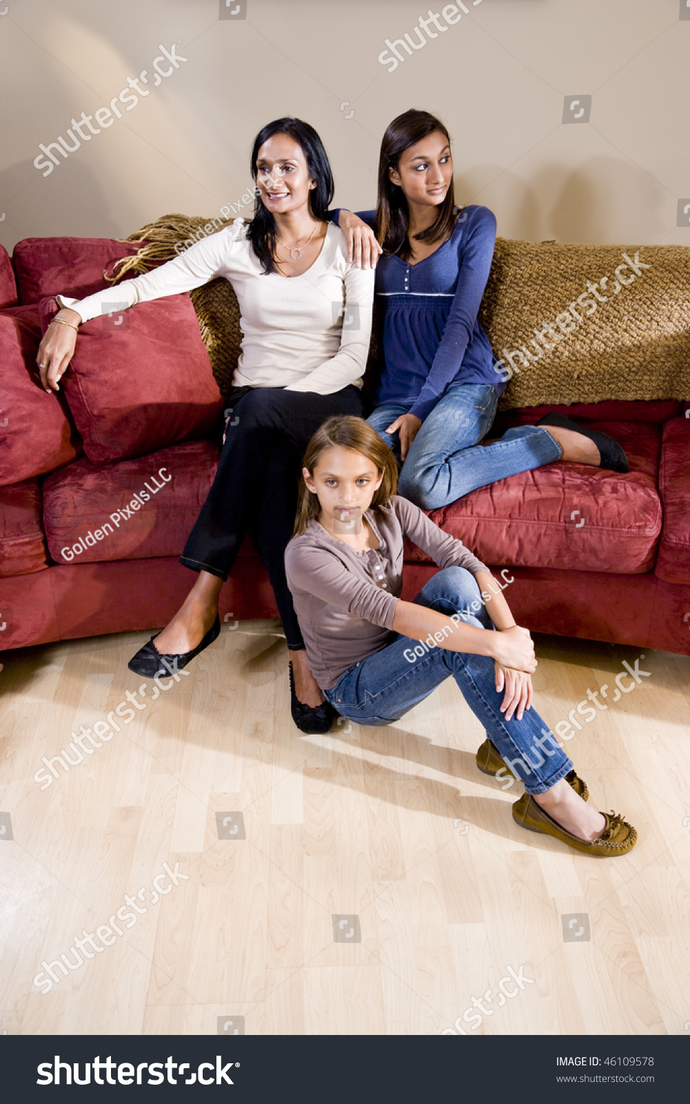 indian mother and two mixed race daughters sitting