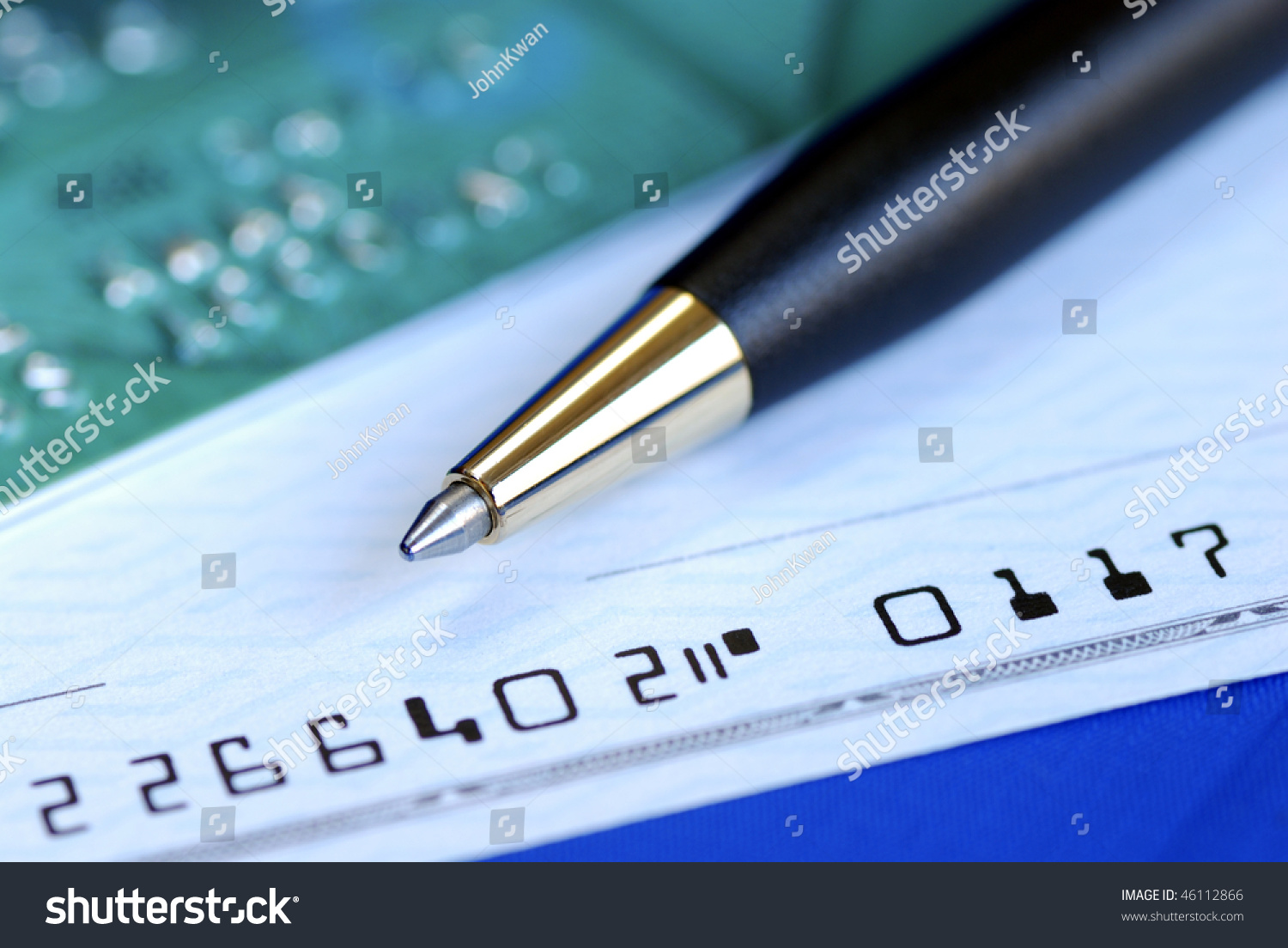 Write A Check To Pay The Credit Card Bill Isolated On Blue Stock
