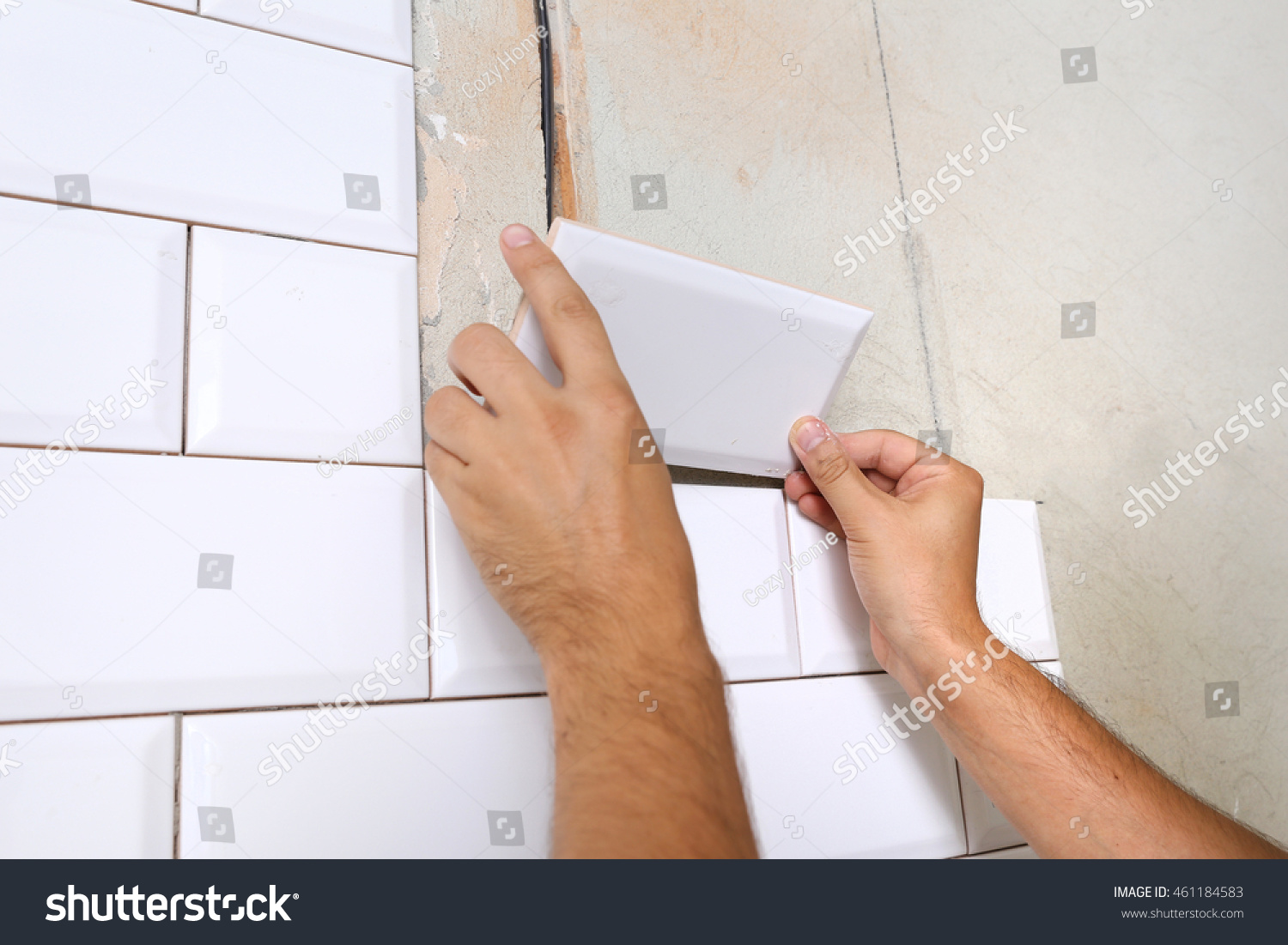 Rectangular white ceramic tile chamfer on stock photo 461184583 rectangular white ceramic tile with a chamfer on the kitchen wall tiler hands in the dailygadgetfo Images