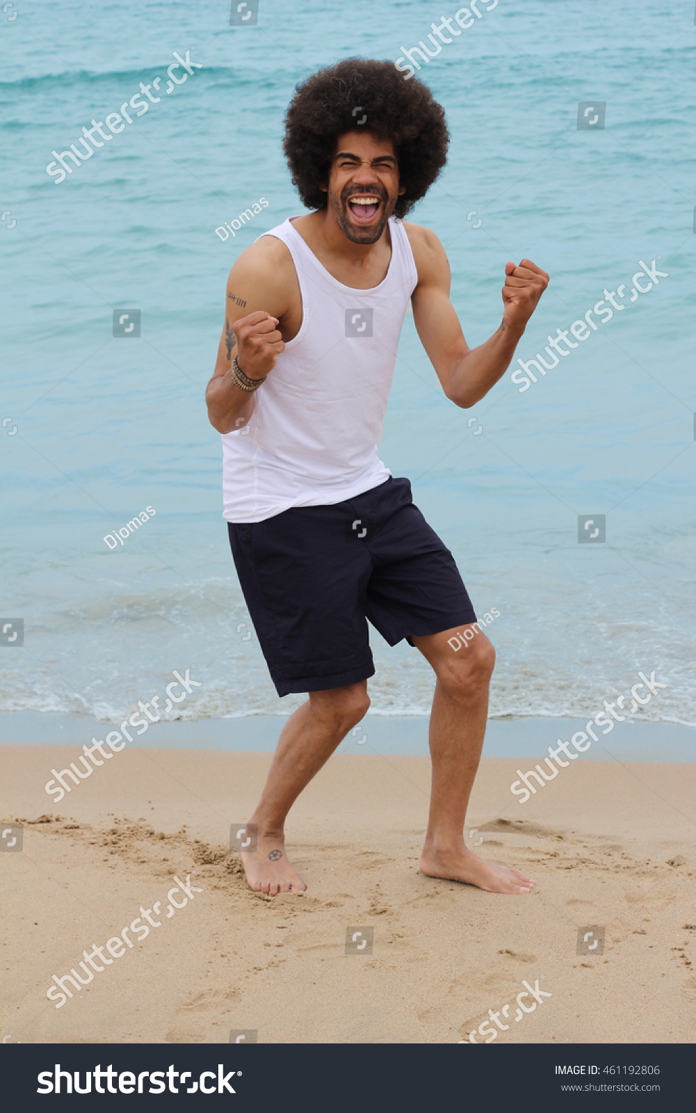afro man on beach stock photo royalty free 461192806 shutterstock