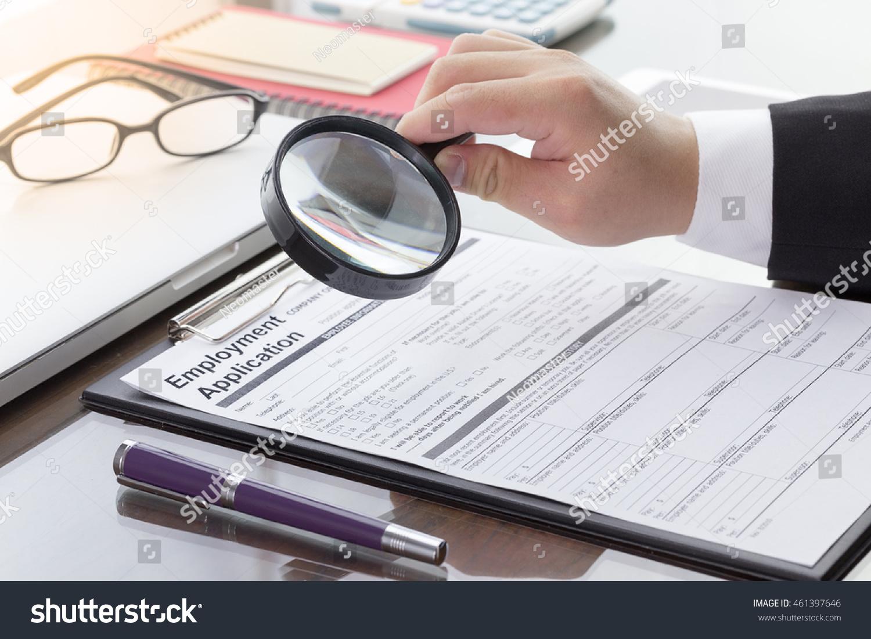 Businessman job seeker fill employment application stock photo businessman or job seeker fill in employment application form with pen job vacancy concept falaconquin