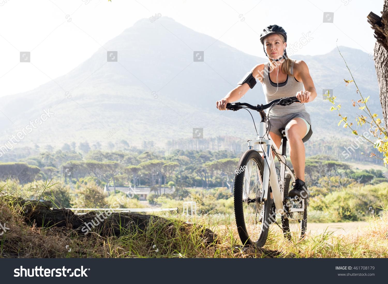 portrait senior woman riding mountain bike stock photo (royalty free