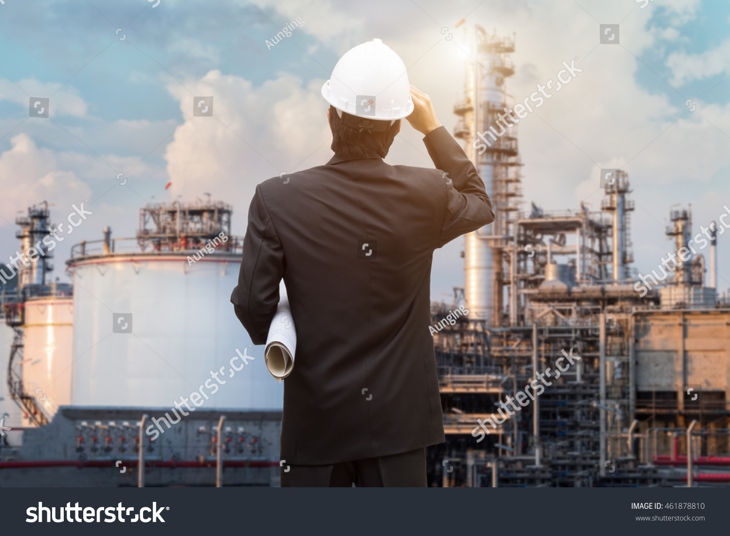 Management consulting engineers working holding blueprint stock management consulting with engineers working and holding blueprint engineer designer with helmet holding blueprint in his malvernweather Image collections
