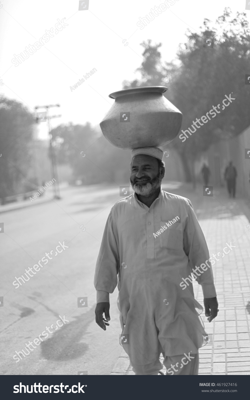 Peshawar pakistan may an old man bringing a port of milk on his