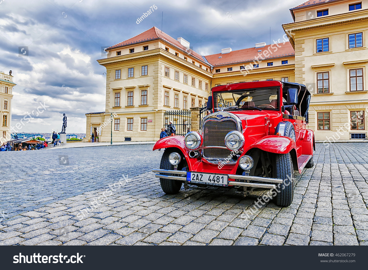 PRAGUE CZECH REPUBLIC MAY-17 Red old car waiting for tourists on the street in Prague on May 17 2016 These cars are usually rented by tourists visiting Prague