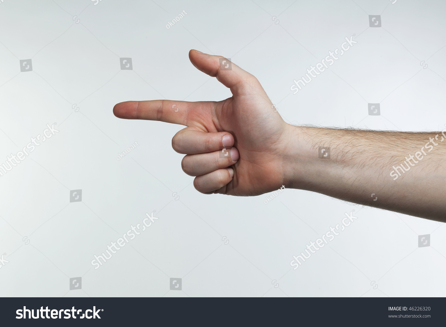 Man'S Hand Pointing Fingers In A Shape Of A Gun Stock ...
