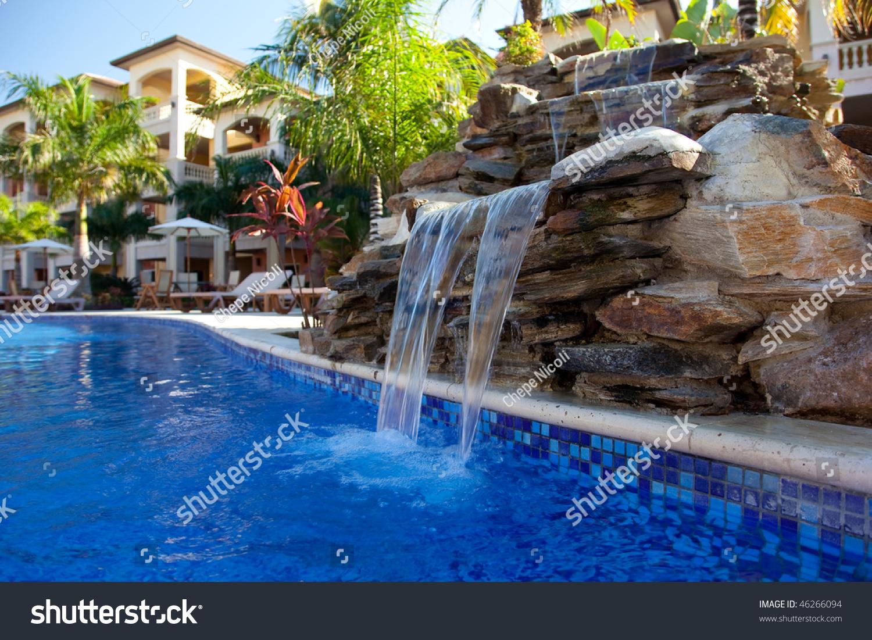 Beautiful swimming pool waterfall in the caribbean stock for Beautiful swimming pools with waterfalls