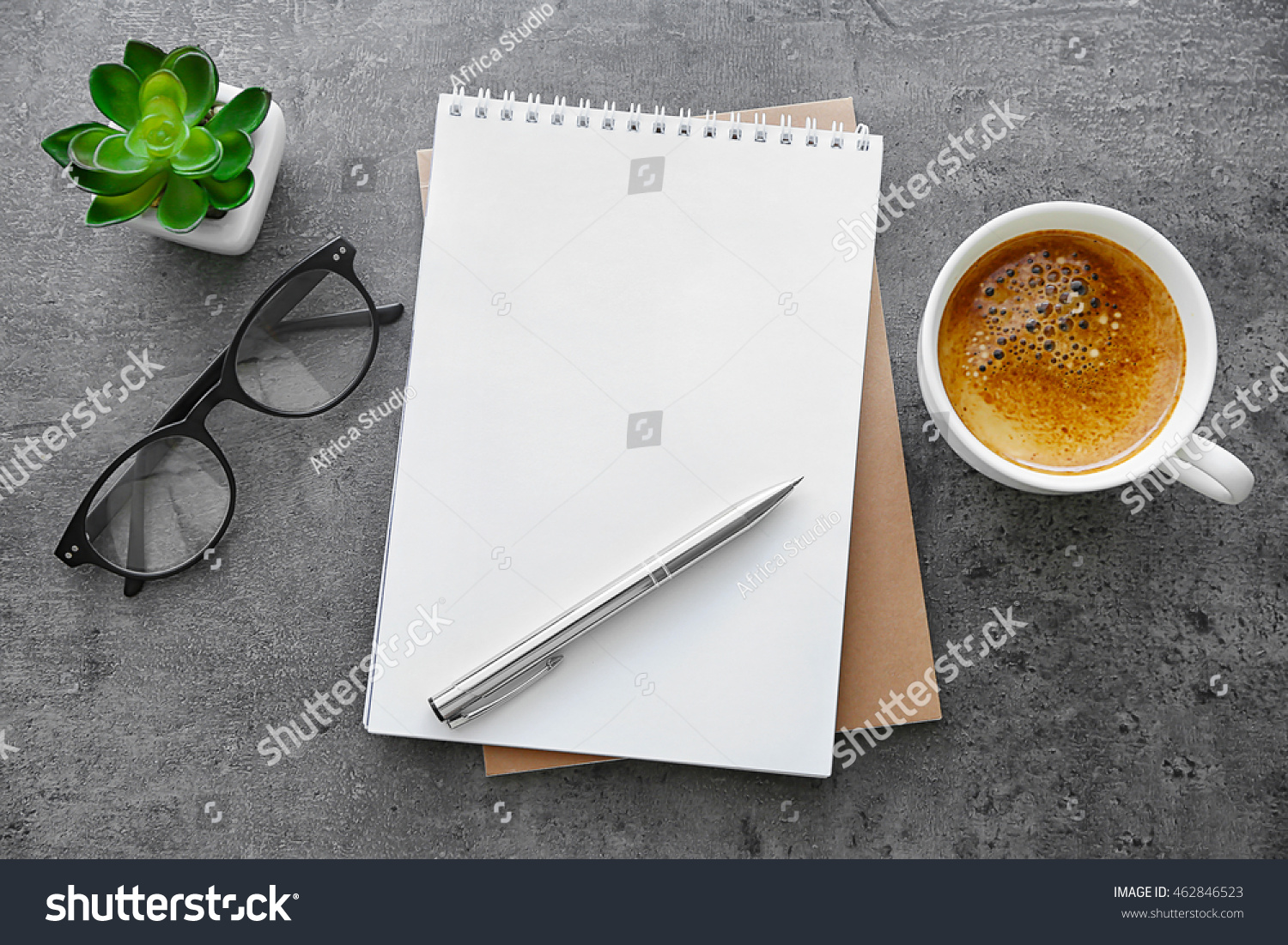School notebook with glasses and coffee on table #462846523